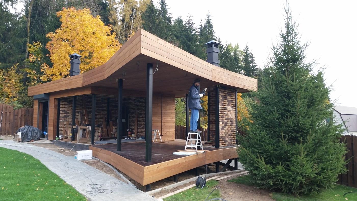 holzhaus mit einem flachdach. Black Bedroom Furniture Sets. Home Design Ideas